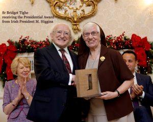Sr Bridget receiving Award from Irish President