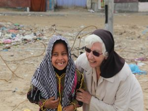 Sr. Bridget and child in traditional dress