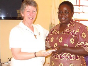 Sr. Jane Bertelsen, Congregational Leader hands appointment to Sr. Christiana Thomas, Leader for FMDM Nigeria